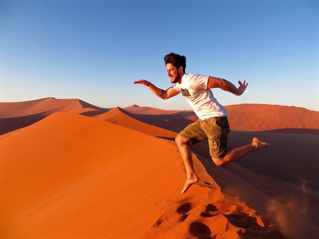A MAN JUMP IN DESERT