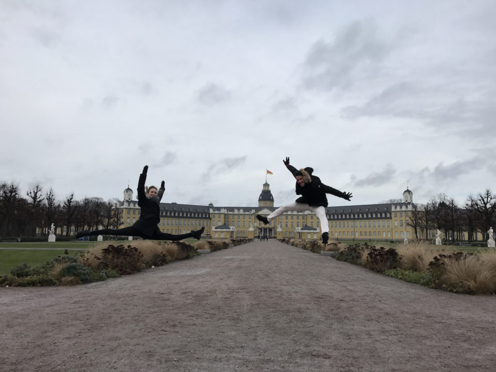 Jumping in front of Karlsruhe Schloss in Germany