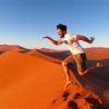 ROLLING DOWN DUNE 45 AT NAMIB DESERT IN NAMIBIA