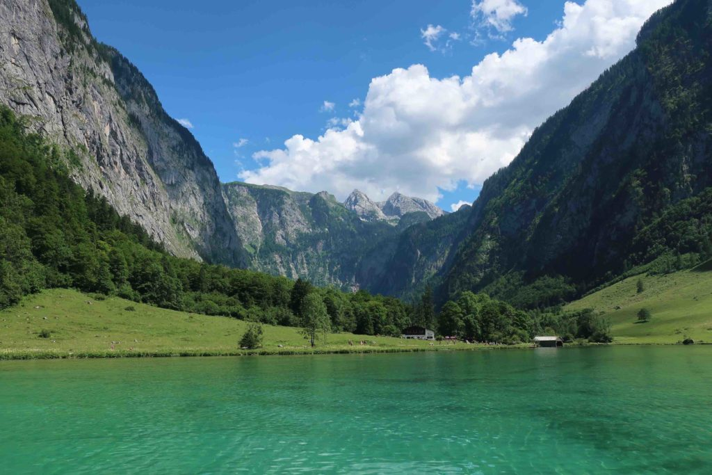 Sailing on the Königsee lake in Germany surrounded by the Alps