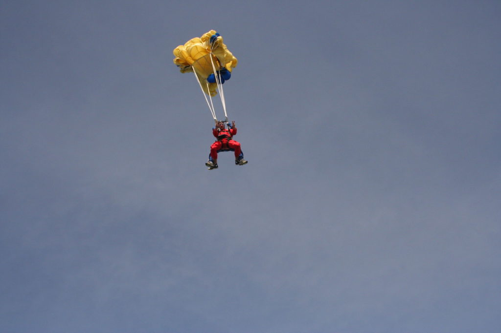 A MAN WITH PARACHUTE